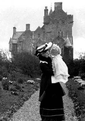 A woman and her baby outside Ackergill Tower